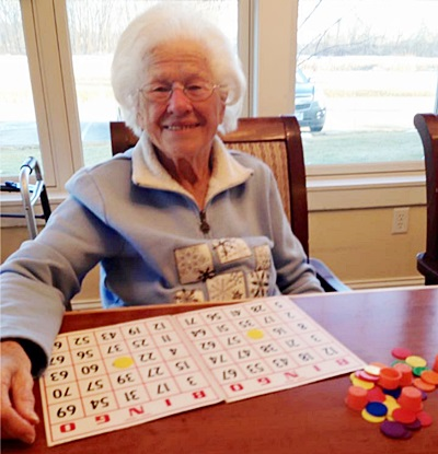 Resident Playing Bingo Elder Care Cottages Of Wisconsin